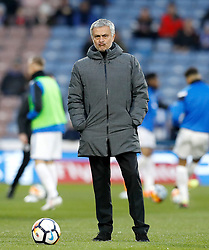 Manchester United manager Jose Mourinho watches over the warm up before the Emirates FA Cup, Fifth Round match at The John Smith's Stadium, Huddersfield.