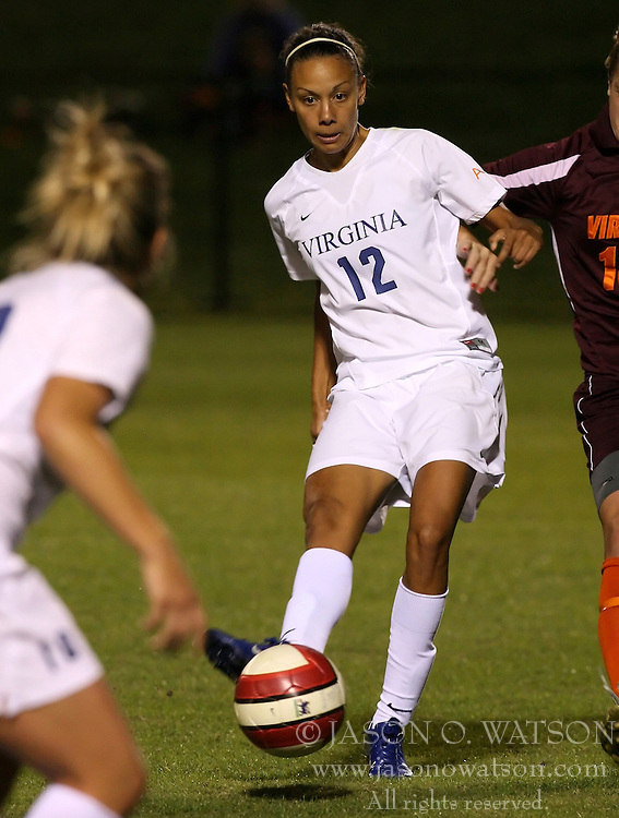 Jess Rostedt passes the ball to Kelly Quinn in action against the Virginia Tech Hokies.  UVA beat VT, 2-1 in Charlottesville, VA.