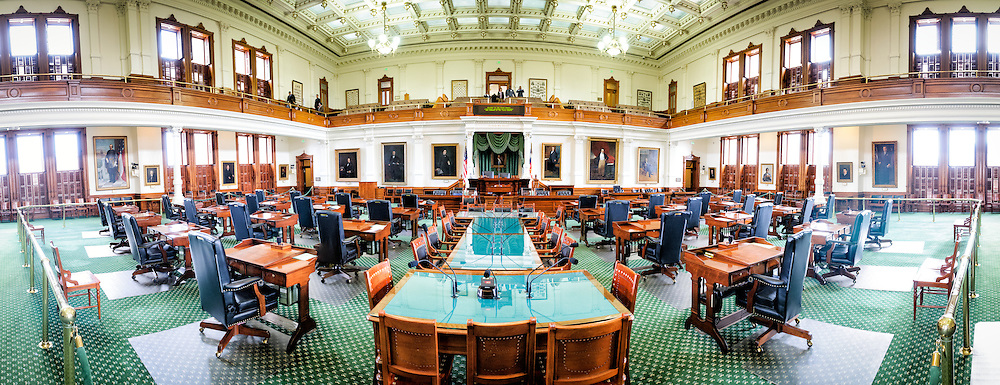 Panorama of the interior of the Senate Chamber in the Texas State Capitol in Austin, Texas. The Texas State Senate consists of 31 Senators, with each having their own desk in the chamber. The floor is lined with a distinctive green carpet that helps make it distinct from the House of Representatives.