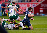 London Irish Fly-half Paddy Jackson clings onto Sale Sharks flanker Cameron Neild during a Gallagher Premiership Round 14 Rugby Union match, Sunday, Mar 21, 2021, in Eccles, United Kingdom. (Steve Flynn/Image of Sport)