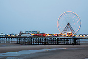 The Blackpool Big Wheel lit-up at dusk on Central Pier, Blackpool, Lancashire, England, United Kingdom.  Designed by John Isaac Mawson and opened in 1868, of the three piers, the Central Pier's emphasis is on fun.  (photo by Andrew Aitchison / In pictures via Getty Images)