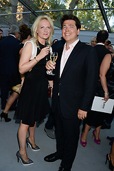 MICHAEL MCINTYRE and his wife KITTY at the Glamour Women of the Year Awards in association with Pandora held in Berkeley Square Gardens, London on 4th June 2013.