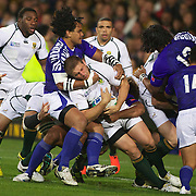 Maurie Fa'asavalu, Samoa, tackles Francois Steyn, South Africa during the South Africa V Samoa, Pool D match during the IRB Rugby World Cup tournament. North Harbour Stadium, Auckland, New Zealand, 30th September 2011. Photo Tim Clayton...
