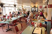 People eating inside the Ferry Cafe, Felixstowe Ferry, Suffolk, England, UK