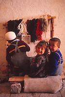 turkish children, at carpet weaving loom