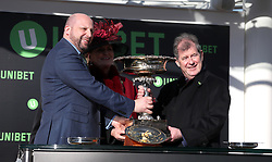 Winning owner John P McManus (right) collects the trophy after Buveur D'Air won the Unibet Champion Hurdle during Champion Day of the 2018 Cheltenham Festival at Cheltenham Racecourse