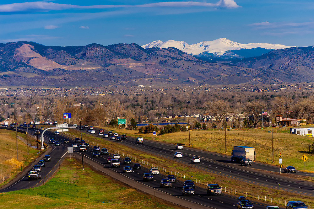 Highway C470 (a ring road around the west and south sections of Metro Denver that connects I70 with I25) with the Rocky Mountains in background, Littleton, Colorado USA.