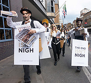 Members from The Alchemist UK, a theatrical themed cocktail bar, hand out fake Brexit themed newspapers on the 23rd May 2019 in London in the United Kingdom.