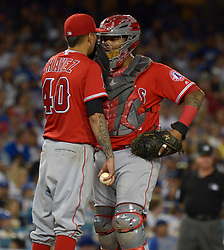 June 28, 2017 - Los Angeles, California, U.S. - Los Angeles Angels starting pitcher Jesse Chavez (40) talks with catcher Martin Maldonado during a Major League baseball game against the Los Angeles Dodgers at Dodger Stadium on Tuesday, June 27, 2017 in Los Angeles. (Photo by Keith Birmingham, Pasadena Star-News/SCNG) (Credit Image: © San Gabriel Valley Tribune via ZUMA Wire)