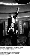 Guy Farley carrying Francis Hawkwright during the Cinderella Ball. Dorchester Hotel. London. December 1982. Film 8249f16.<br />© Copyright Photograph by Dafydd Jones. 66 Stockwell Park Rd. London SW9 0DA. Tel 0171 733 0108
