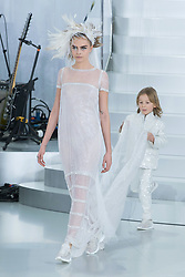 File photo - Model Cara Delevingne displays a creation by German designer Karl Lagerfeld for Chanel Spring-Summer 2014 Haute-Couture collection show held at the Grand Palais, in Paris, France on January 21, 2014. Karl Lagerfeld died on Monday at age 85. One who may inherit is his godson Hudson. Hudson's dad, model Brad Kroenig, is like 'family' to Lagerfeld. Hudson began modeling for Chanel at age two and had continued to pop up on the runway ever since. Photo by Christophe Guibbaud/ABACAPRESS.COM