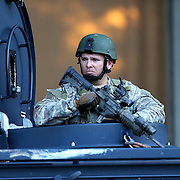 A law enforcement officer stands guard in an armored vehicle as agents search for suspect Markeith Loyd at the Tzadik Brookside Apartments on January 9 2017 in Orlando, Florida. Loyd shot an Orlando Police officer earlier in the day at a local Walmart, the officer has since died.  (Alex Menendez via AP)