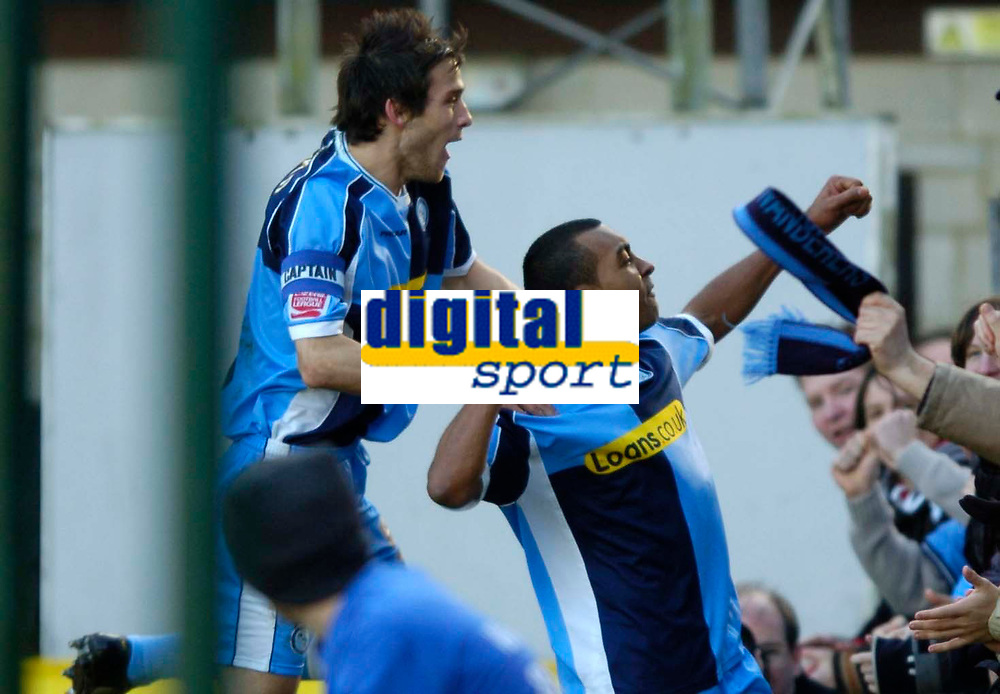 Photo: Richard Lane.<br />Wycombe Wanderers v Oxford United. Coca Cola League 2. 25/02/2006. <br />Wycombe's Kevin Betsy celebrates his goal with Roger Johnson.
