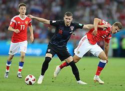 SOCHI, July 7, 2018  Roman Zobnin (R) of Russia vies with Ante Rebic (C) of Croatia during the 2018 FIFA World Cup quarter-final match between Russia and Croatia in Sochi, Russia, July 7, 2018. (Credit Image: © Yang Lei/Xinhua via ZUMA Wire)