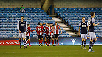 Football - 2019 / 2020 Emirates FA Cup - Fourth Round: Millwall vs. Sheffield United<br /> <br /> Despondent Millwall players trudge back as Sheffield United players celebrate at The Den.<br /> <br /> COLORSPORT/DANIEL BEARHAM