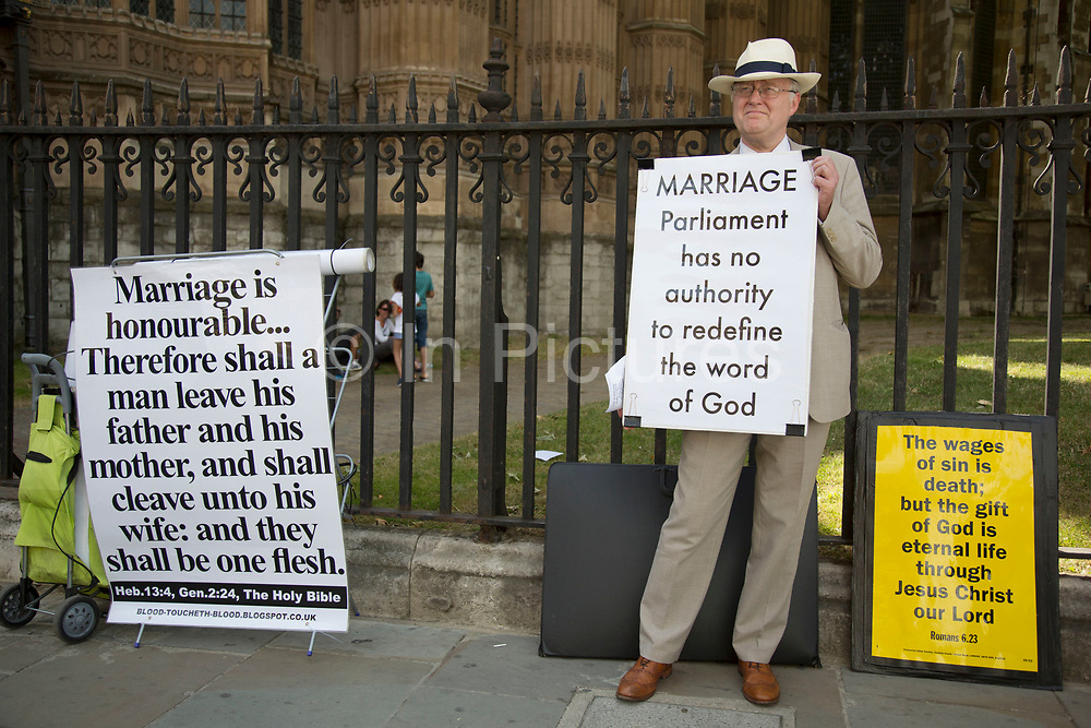 Demonstrator against same sex marriage outside Parliament in London, UK, ahead of the final reading of the 'Marriage Bill 2012-13 to 2013-14'. A Bill to make provision for the marriage of same sex couples in England and Wales.