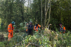 Denham, UK. 29th September, 2020. Security guards working on behalf of HS2 Ltd monitor an environmental activist objecting to the felling of trees in Denham Country Park for works connected to the HS2 high-speed rail link. Anti-HS2 activists based at the nearby Denham Ford Protection Camp and protesting against the destruction of the woodland contend that the area of Denham Country Park currently being felled is not indicated for felling on documentation supplied by HS2 Ltd.