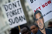 George Clooney lends his support (as a carboard figure). A protest on behalf of the Nuba people to express disgust and request immediate intervention by the UK government to protect against human rights violations in Sudan and Darfur and to bring those members of the Khartoum police responsible for the murder of Awadiya Aajabna to justice. Opposite Downing St, Whitehall, London, UK, 31 March 2012.  Guy Bell, 07771 786236, guy@gbphotos.com