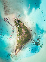 Aerial view of touristic bungalow in Bora-Bora island, in French Polynesia.