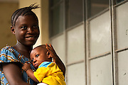 Elizabeth Farma, 16, holds her two-month-old son Emmanuel near the Bonthe district hospital in Bonthe, Sierra Leone on Wednesday April 21, 2010. Elizabeth still attends high school, and leave the child with her grandmother while she is in class.