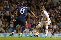 29.08.2013, White Hart Lane, London, ENG, UEFA CL Qualifikation, Tottenham Hotspur vs FC Dinamo Tiflis, Rueckspiel, im Bild Dinamo Tbilisi's Levan Khmaladze and Tottenham's Gylfi Sigurosson compete for the ball during the UEFA Europa League Qualifier second leg match between Tottenham Hotspur and FC Dinamo Tiflis Zuerich at the White Hart Lane in London, England on 2013/08/29 . EXPA Pictures © 2013, PhotoCredit: EXPA/ Mitchell Gunn <br /> <br /> ***** ATTENTION - OUT OF GBR *****