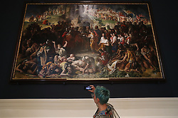 Alexandra Day of Trinity college's art magazine TN2 takes a photo of 'The Marriage Of Strongbow And Aoife' by Daniel Maclise on it's return to display in the refurbished National Gallery of Ireland, Dublin.