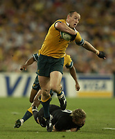 Photo: Richard Lane.<br />New Zealand v Australia. Semi-Final, at the Telstra Stadium, Sydney. RWC 2003. 15/11/2003. <br />Striling Mortlock breaks past Justin Marshall.