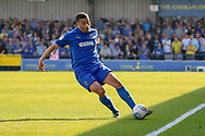 AFC Wimbledon defender Rod McDonald (26) passing the ball during the EFL Sky Bet League 1 match between AFC Wimbledon and Bristol Rovers at the Cherry Red Records Stadium, Kingston, England on 19 April 2019.