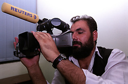 Ismail Samin, Reuters' correspondent, testing his camera before the press conference at the Governour of Kandahar's residence.