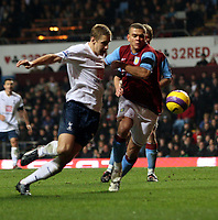 Photo: Mark Stephenson/Sportsbeat Images.<br /> Aston Villa v Tottenham Hotspur. The FA Barclays Premiership. 01/01/2008.Villa's Wilfred Bouma holds off Tottenham's Michael Dawson