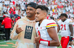 Sep 4, 2021; College Park, Maryland, USA; Maryland Terrapins quarterback Taulia Tagovailoa (3) poses for a photo with his older brother, Miami Dolphins quarterback Tua Tagovailoa after defeating the West Virginia Mountaineers at Capital One Field at Maryland Stadium. Mandatory Credit: Ben Queen-USA TODAY Sports