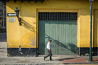 LIMA, PERU - CIRCA APRIL 2014: Man walking in Calle del Arzobispado in the Lima Historic Centre in Peru