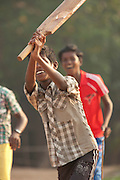 Young boys playing cricket on Poovar Beach in the morning, near Trivandrum (Thiruvananthapuram), Kerala, India