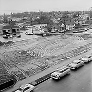 Y-610214-04.  Emanuel Hospital construction progress. Empty lot. North Commercial Avenue between Graham & Stanton. February 14, 1961