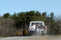 4/5/04 (lft-rt) Bob Crawford, 33, Seth Avett, 23 and Scott Avett, 27, ride in the back of Scott's 1st car, a 1971 Ford pick-up truck. They have been playing together for three years as the Avett Brothers. Their music has been called everything from alternative bluegrass to depression dance music. L.MUELLER/The Charlotte Observer