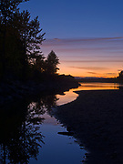 Sunset reflected in the Middle Fork Flathead National Scenic River at Cascadilla Creek's mouth, Flathead National Forest and Glacier National Park, Montana.