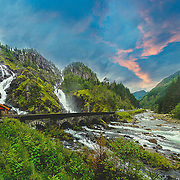 Låtefoss is one of the most visited nature attractions in Norway! Låtefoss waterfall is a famous twin waterfall close to Route 13 in Oddadalen valley. The pair of waterfalls tumbled from a height of 165m. Four pictures has been stitched together using PS. Please feel free to check my photos here or find me by: |Website| ,|Facebook page| , |Instagram| ,|Google+| ,|Twitter |. Now fulI story : I was with my colleague, Einar, were traveling from Trondheim in mid Norway to Bømlo in southwest of the country. We went by car which takes about 12 hours driving (without stopping) but as we stopped to have some rest we couldn't managed to drive the whole route in one day. The road was really beautiful, everywhere was new for me. Although, Einar as a Norwegian already had seen all the places, especially because he is a field geophysicist and also a climber but he told me he also enjoying to see these incredible nature again and again. I was amazed by very attractive landscapes, long waterfalls, high mountains and beautiful rivers. We didn't have enough time to stop in every touristic places but believe me or not it was like a live discovery channel for me.