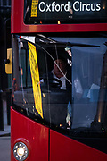 Seen reflected in the windscreen of a passing bus are images and video clips from retail ads at Piccadilly Circus in the capitals West End, on 5th February 2021, in London, England.