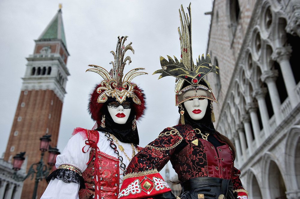 VENICE, ITALY - FEBRUARY 20: Two women wearing Carnival costumes and masks pose in St Mark Square on February 20, 2011 in Venice, Italy. The Venice Carnival, one ofthe largest and most important in Italy, attracts thousands of people from around the world each year. The theme for this year's carnival is Ottocento amd Sissi, a nineteenth century evocation, andwill runfrom February 19 till March 8.