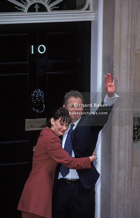 The newly-elected British Labour Prime Minister Tony Blair stands on the steps of Number 10 Downing Street with his wife Cherie the morning after his landslide election victory over the Conservative John Major, on 2nd May 1997, in Westminster, London, England.