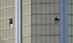 Oct 3,2017. Las Vegas NV.  Two windows that were smash open by the suspect at the Mandalay Bay after Sundays mass shooting.  The latest on victims as of Tuesday is still 59 dead, 527 injured last reported Monday night.  The shooting happen during day 3 of the Route 91 Harvest Festival.. Photo by Gene Blevins/ZumaPress. (Credit Image: © Gene Blevins via ZUMA Wire)