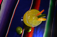 A gold margarita with fruit.