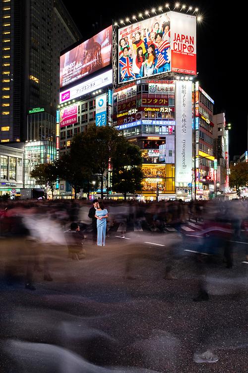 Couple having a photoshoot at the Shibuya Crossing, Tokyo.