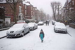 © Licensed to London News Pictures. 24/01/2021. London, UK. A child walks through heavy Snowfall on Parliament Hill in Hampstead in north London. Parts of the UK continue to suffer from flooding caused by Storm Christoph. Photo credit: Ben Cawthra/LNP