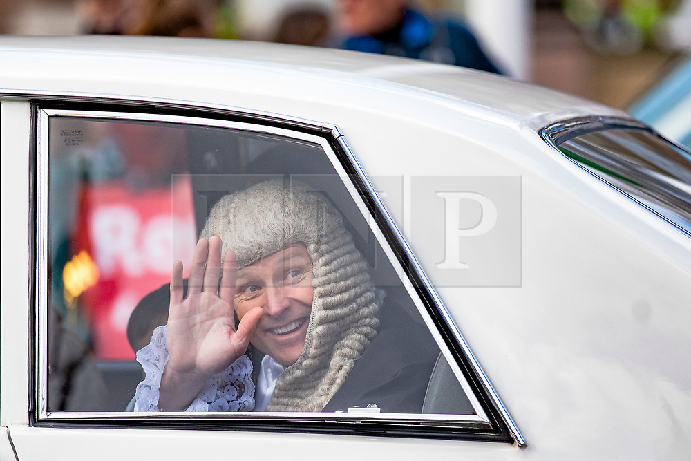 © Licensed to London News Pictures. 11/03/2019. London, UK. A newly-appointed QC waves form the back of a limousine as he leaves the Palace of Westminster after the Silks Ceremony.  Photo credit: Rob Pinney/LNP