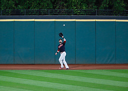 October 11, 2017 - Cleveland, OH, USA - Cleveland Indians center fielder Jason Kipnis fields a fly ball to retire the New York Yankees' Aaron Hicks in the fourth inning during Game 5 of the American League Division Series, Wenesday, Oct. 11, 2017, at Progressive Field in Cleveland. (Credit Image: © Leah Klafczynski/TNS via ZUMA Wire)