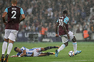 Tom Ince of Huddersfield Town slides in and attempts to tackle Michail Antonio of West Ham united.  Premier league match, West Ham Utd v Huddersfield Town at the London Stadium, Queen Elizabeth Olympic Park in London on Monday 11th September 2017.<br /> pic by Kieran Clarke, Andrew Orchard sports photography.