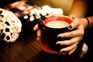 Hands hold a mug of coffee in a Hanoi cafe, Vietnam, Southeast Asia