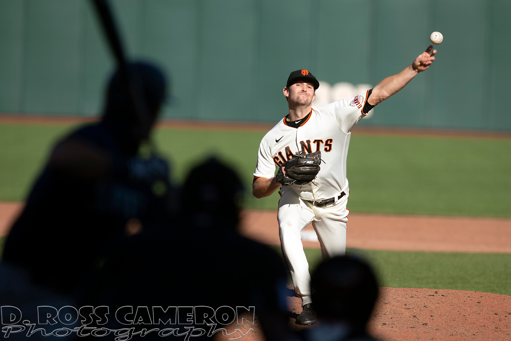 San Francisco Giants pitcher Sam Selman (67) delivers a pitch against the Seattle Mariners during the ninth inning of a Major League Baseball game, Thursday, Sept. 17, 2020 in San Francisco. Selman picked up his first Major League save as the Giants defeated the Mariners 6-4. This is a makeup of a postponed game from Wednesday in Seattle. (AP Photo/D. Ross Cameron)