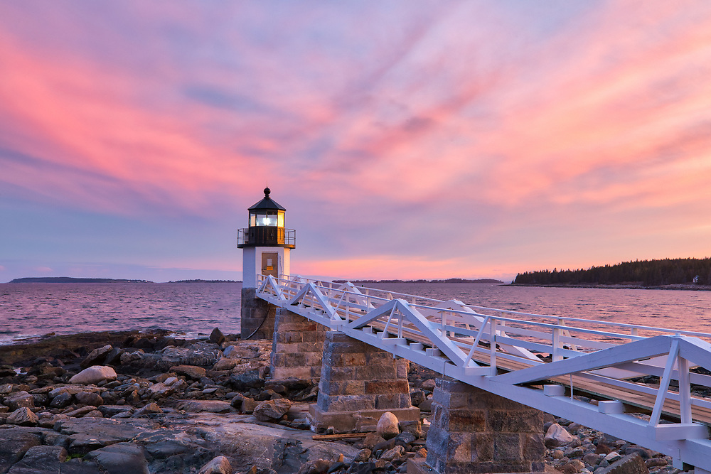Maine photography of Marshall Point Lighthouse with its iconic wooden walkway. This beautiful New England lighthouse is located in Port Clyde, ME and marks the entrance to Port Clyde harbor.<br /> <br /> This picturesque Maine lighthouse photography image is available as museum quality photography prints, canvas prints, acrylic prints, wood prints or metal prints. Fine art prints may be framed and matted to the individual liking and interior design decorating needs:<br /> <br /> https://juergen-roth.pixels.com/featured/port-clyde-marshall-point-light-juergen-roth.html<br /> <br /> Good light and happy photo making!<br /> <br /> My best,<br /> <br /> Juergen<br /> Photo Prints: http://www.rothgalleries.com<br /> Photo Blog: http://whereintheworldisjuergen.blogspot.com<br /> Instagram: https://www.instagram.com/rothgalleries<br /> Twitter: https://twitter.com/naturefineart<br /> Facebook: https://www.facebook.com/naturefineart